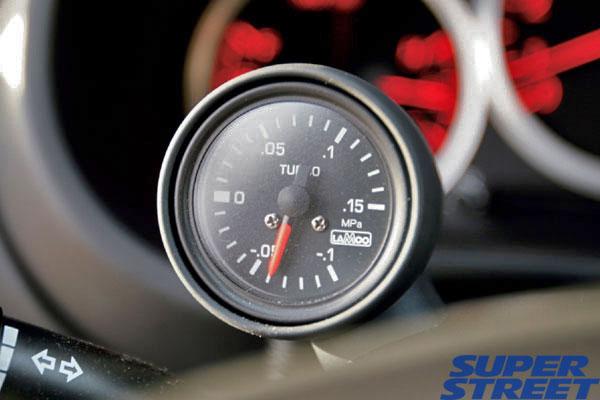 An OEM Subaru Steering Column Pod with Lamco Gauge